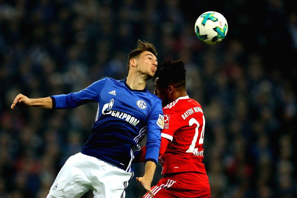 GELSENKIRCHEN, Sept. 20, 2017 - Leon Goretzka (L) of Schalke 04 vies for the ball with Corentin Tolissoof of Bayern Munich during their German Bundesliga match in Gelsenkirchen, Germany, on Sept. 19, ...