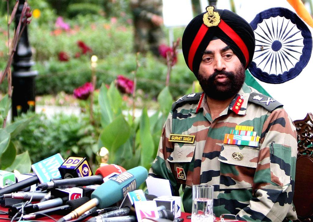 General Officer Commanding (GOC) 15 Corps Lt Gen Gurmeet Singh addressing media persons at Badami Bagh head quarter in Srinagar on August 16, 2013. (Photo::: IANS) - Gurmeet Singh