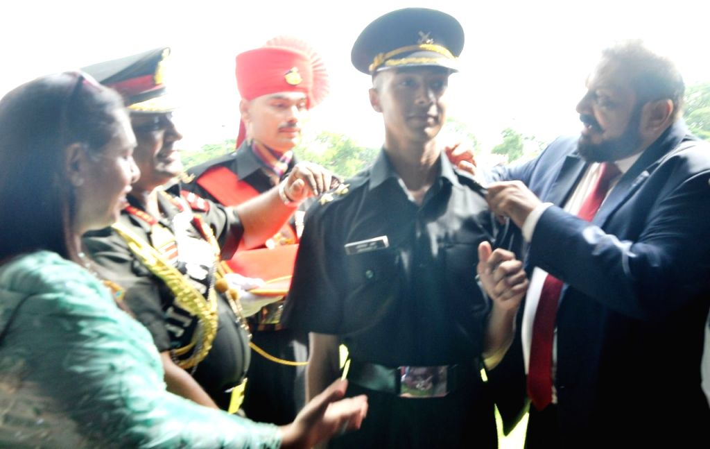 General Officer Commanding-in-Chief, Southern Command Lieutenant General PM Hariz present gold medal to Academy Under Officer (AUO) Abhishek R during the Passing out Parade at Officers ...
