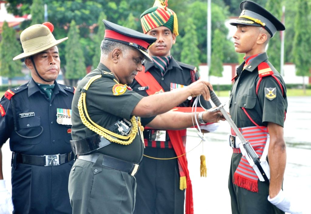 """General Officer Commanding-in-Chief, Southern Command Lieutenant General PM Hariz present """"Sword of Honour"""" to Academy Under Officer (AUO) Abhishek R during the Passing out Parade at ..."""