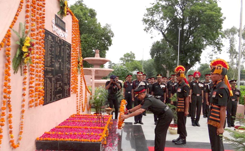 General Officer Commanding of Golden Arrow Division Maj Gen Munish Sibal pays tribute to martyrs at Barki War Memorial on Kargil Vijay Diwas in Ferozepur, on July 26, 2015.