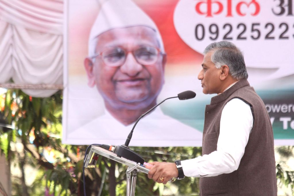General V K Singh addresses at the venue where social activist Anna Hazare is sitting on indefinite hunger strike for passage of Jan Lokpal Bill in Parliament at Ralegaon Siddhi on Dec.13, 2013.