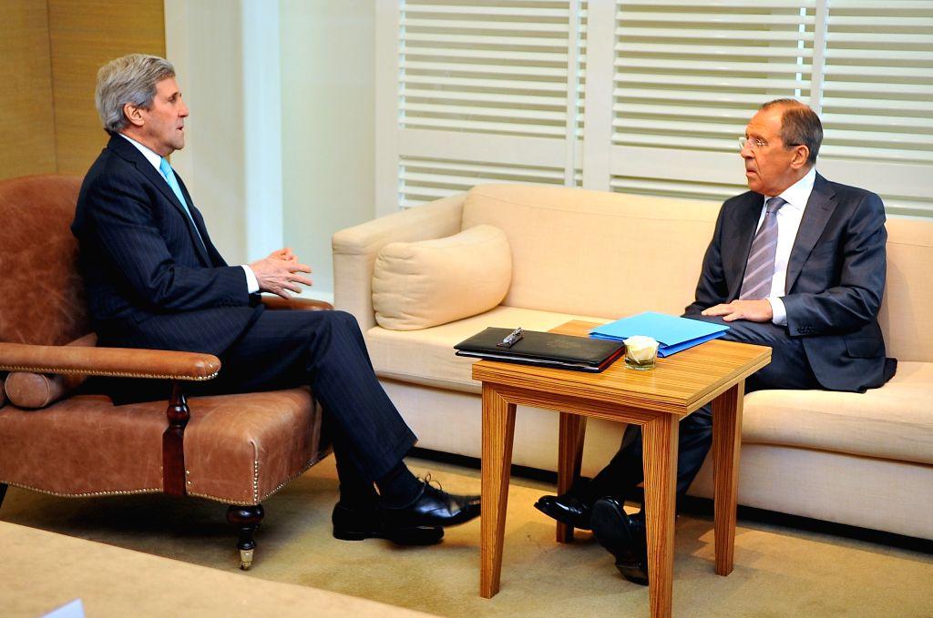 U.S. Secretary of State John Kerry (L) and Russian Foreign Minister Sergei Lavrov hold bilateral talks before talks on Ukraine in Geneva, Switzerland, on April 17, . - Sergei Lavrov