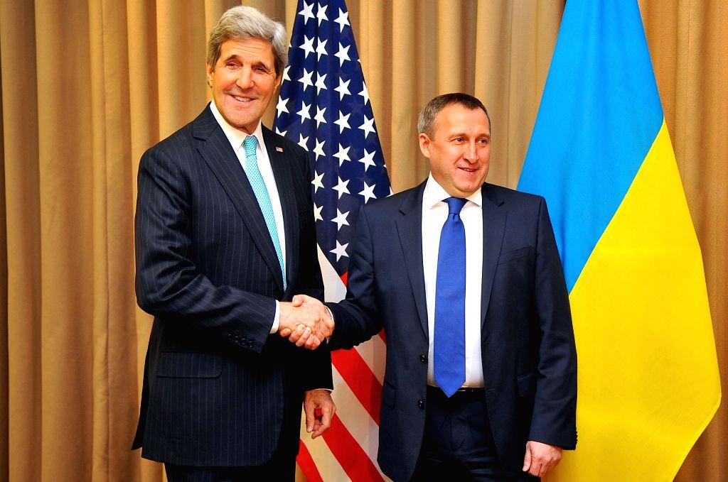 US Secretary of State John Kerry (L) meets with Ukrainian Foreign Minister Andriy Deshchytsya in Geneva, Switzerland, April 17, 2014. John Kerry and Andriy ... - Andriy Deshchytsya