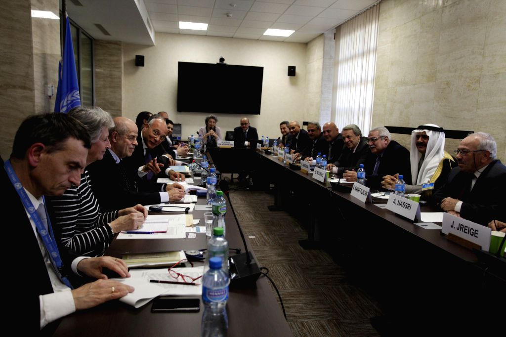 GENEVA, April 20, 2016 - UN Deputy Special Envoy for Syria Ramzy Ezzeldin Ramzy (4th L) attends an internal Syrian opposition delegation meeting in Geneva, Switzerland, on April 19, 2016.