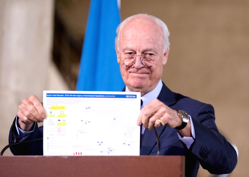 GENEVA, April 21, 2016 - UN Special Envoy for Syria Staffan de Mistura shows a document on UN humanitarian operations in Syria during a press conference in Geneva, Switzerland, April 21, 2016. ...