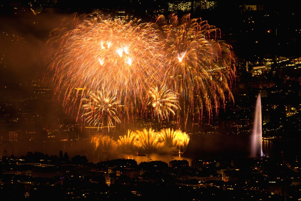 GENEVA, Aug. 12, 2018 - Photo taken on Aug. 11, 2018 shows fireworks illuminating the sky over Lake Leman during the Geneva Festival in Geneva, Switzerland. The Geneva Festival is held annually in ...