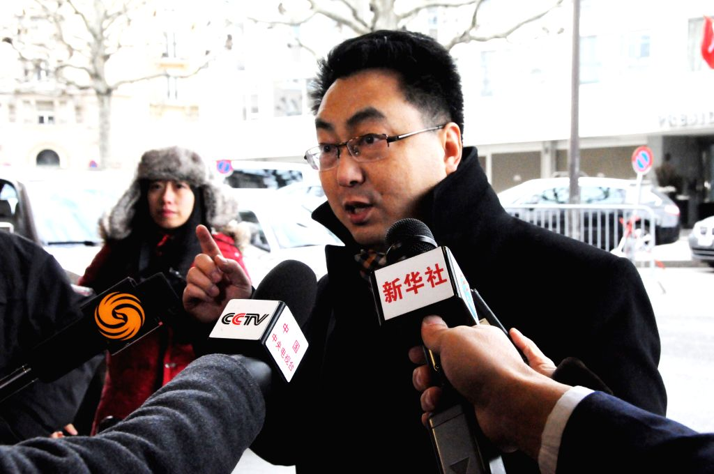 Wang Qun, Director-General of the Department of Arms Control of Chinese Ministry of Foreign Affairs talks to the media prior to the meeting in Geneva, Switzerland, ...