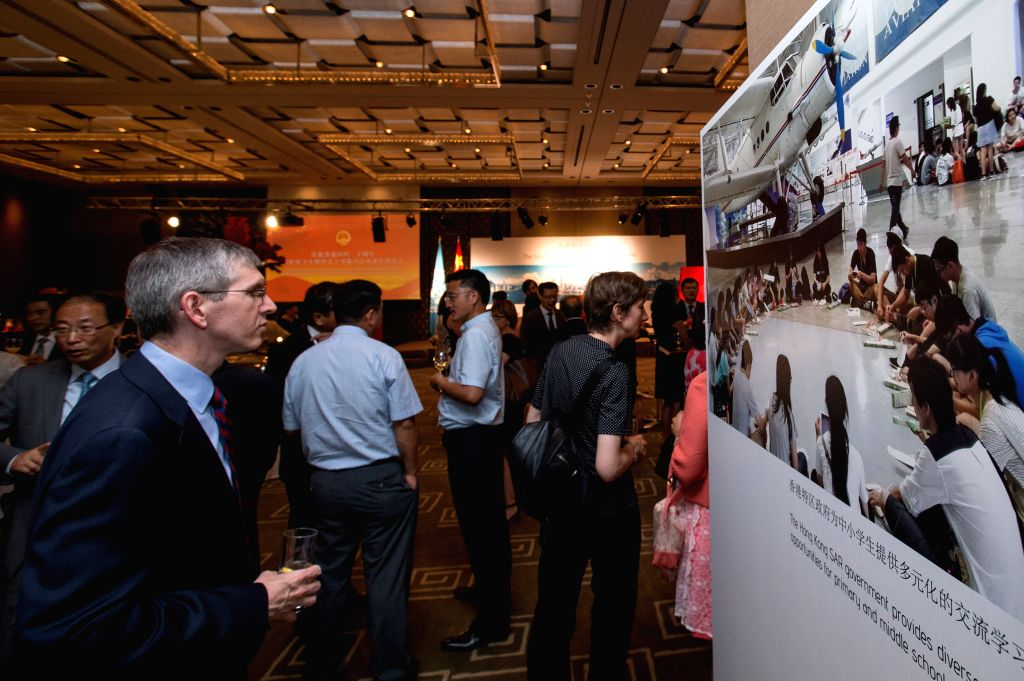 GENEVA, June 23, 2017 - People visit a photo exhibition in Geneva, Switzerland, on June 22, 2017. The photo exhibition was held here Thursday to celebrate the 20th anniversary of Hong Kong's return ...