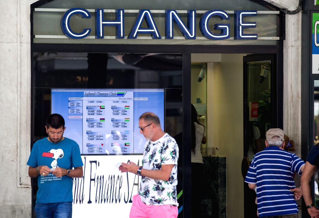 GENEVA, June 24, 2016 - Two men leave a currency exchange shop in Geneva, Switzerland, on June 24, 2016.