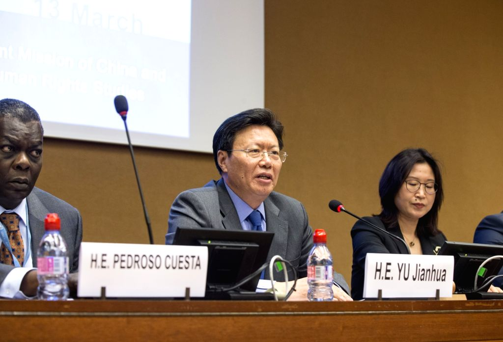 GENEVA, March 14, 2019 - Yu Jianhua (C), head of the China's Mission to the UN Office at Geneva, speaks on a UN side-event as part of the 40th session of the UN Human Rights Council in Geneva, ...