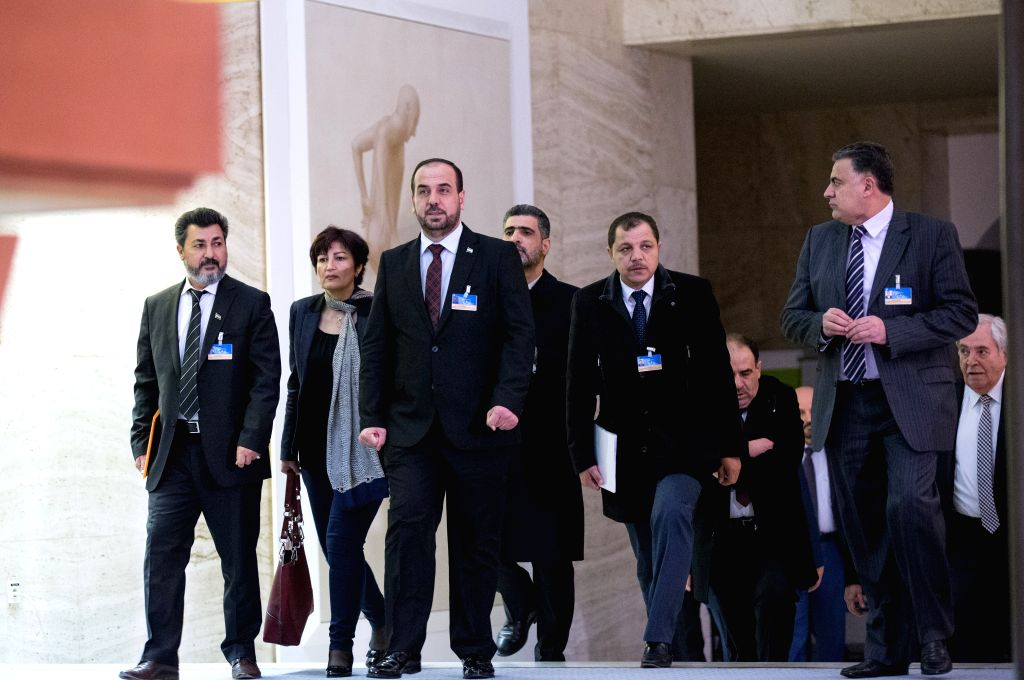 GENEVA, March 3, 2017 - Syria's opposition delegation leader Nasr al-Hariri (front) arrives for a press conference at Palais des Nations in Geneva, Switzerland, March 3, 2017. The latest round of ...