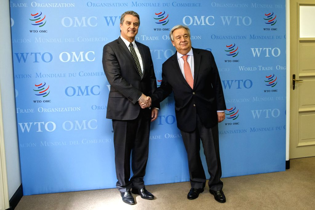 GENEVA, May 11, 2019 - Secretary-General of the United Nations Antonio Guterres (R) shakes hands with Roberto Azevedo, director-general of the World Trade Organization (WTO), at the headquarters of ...