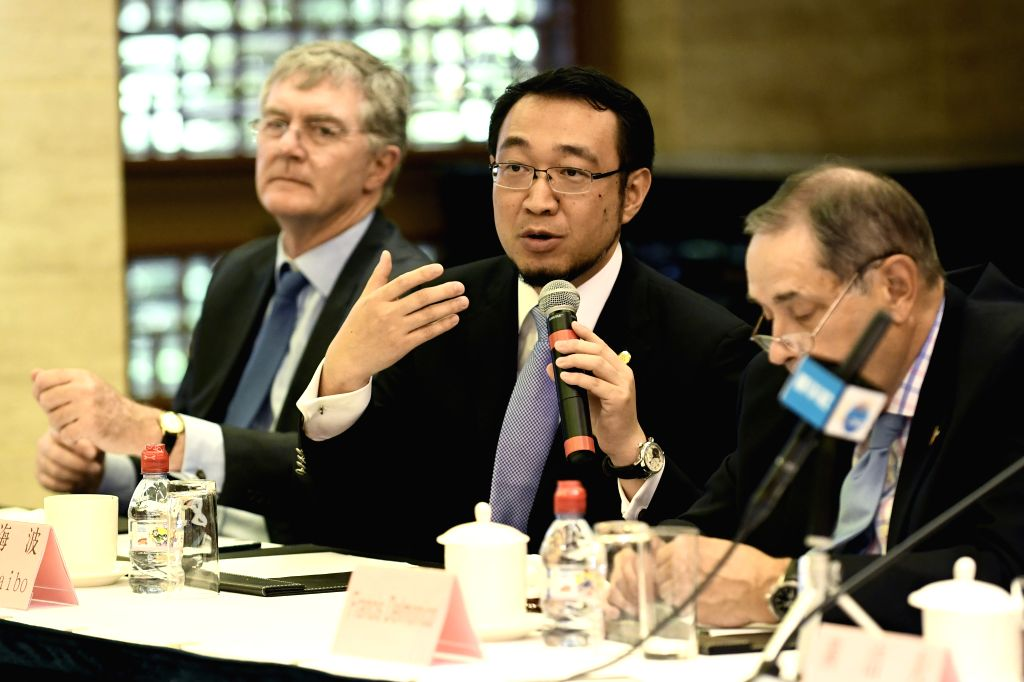 GENEVA, May 25, 2018 - Wang Haibo (C), an expert from the China National Organ Donation and Transplantation Committee, speaks during a press conference in Geneva, Switzerland, on May 25, 2018. ...