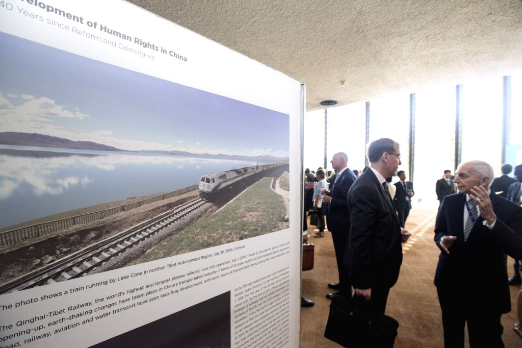 "GENEVA, Sept. 11, 2018 - People visit the exhibition ""Development of Human Rights in China: 40 Years of Reform and Opening-up"" in Geneva, Switzerland, on Sept. 10, 2018. The exhibition ..."
