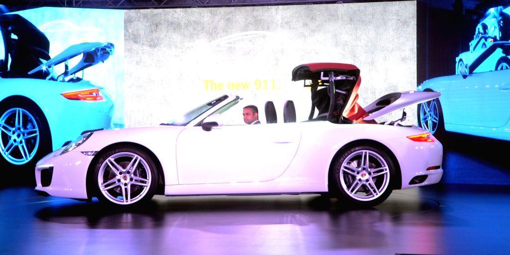 "German automaker Porsche launches its ""911 Carrera"" car in Mumbai on June 29, 2016."