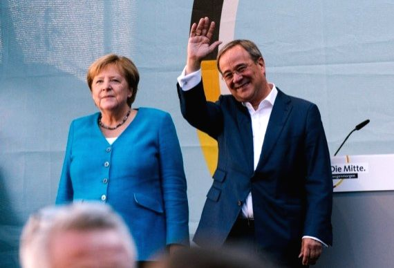 German Chancellor Angela Merkel (L) and Armin Laschet, leader of German Christian Democratic Union (CDU) and chancellor candidate of CDU/Christian Social Union (CSU), attend an election rally of CDU ...