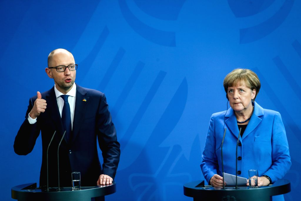 German Chancellor Angela Merkel (R) and Ukrainian Prime Minister Arseniy Yatsenyuk attend the press conference after meeting at the Chancellory, Berlin, Germany, on ... - Arseniy Yatsenyuk