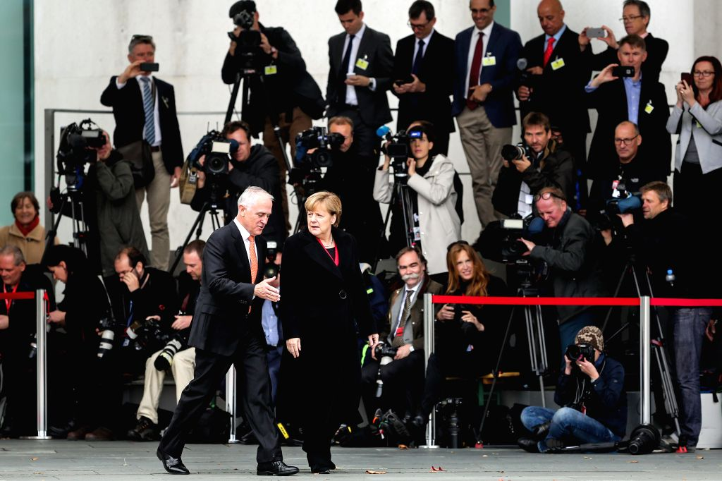 German Chancellor Angela Merkel (R, front) talks with visiting Australian Prime Minister Malcolm Turnbull (L, front) during a welcome ceremony at the Chancellery in ... - Malcolm Turnbull