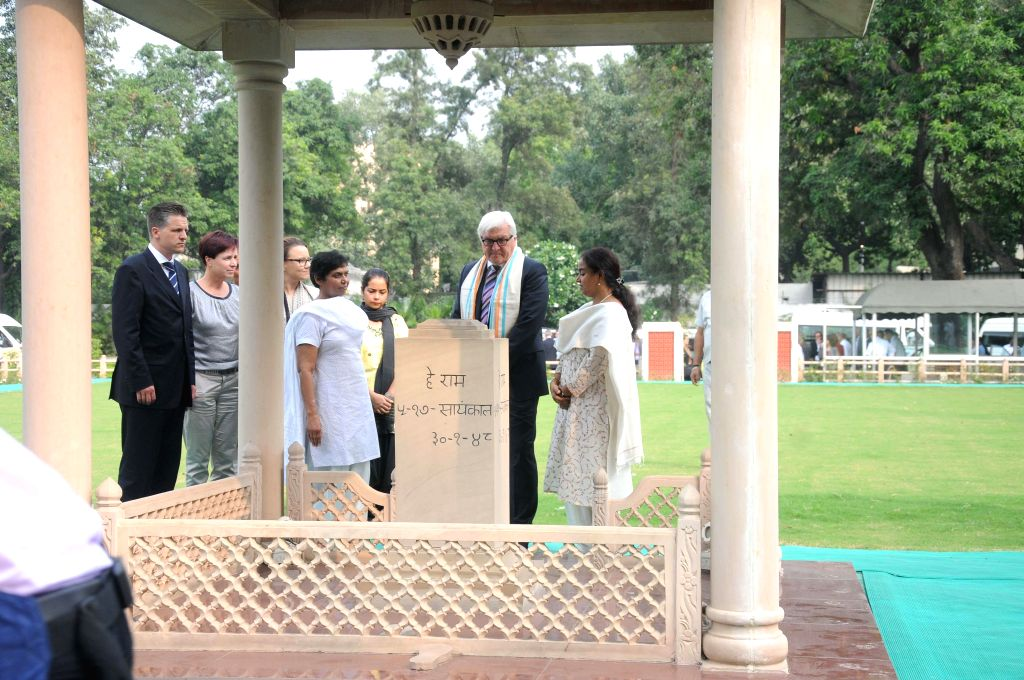 German Foreign Minister Frank-Walter Steinmeier pays homage at the Mahatma Gandhi Memorial in New Delhi on Sept 7, 2014. - Frank-Walter Steinmeier