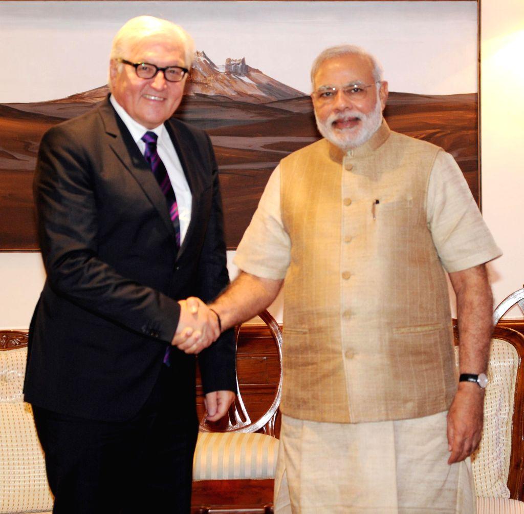 German Foreign Minister Frank-Walter Steinmeier calls on Prime Minister Narendra Modi in New Delhi on September 08, 2014. - Frank-Walter Steinmeier and Narendra Modi