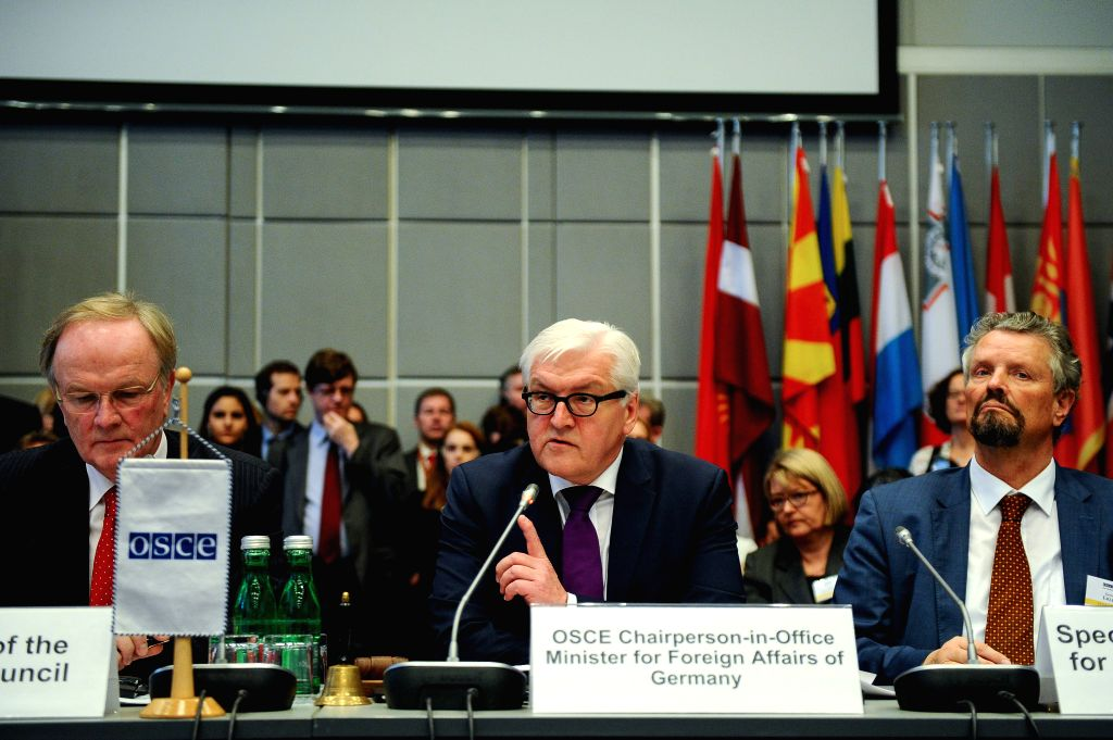 German Foreign Minister Frank-Walter Steinmeier (C) speaks during a session of the permanent council of the OSCE, the Organization for Security and Cooperation in ... - Frank-Walter Steinmeier