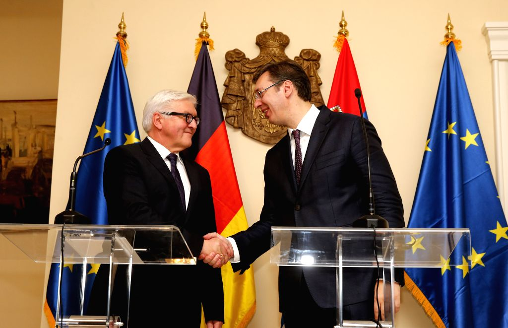 German Foreign Minister Frank-Walter Steinmeier (L) shakes hands with Serbian Prime Minister Aleksandar Vucic (R) during a press conference after their meeting at ... - Frank-Walter Steinmeier