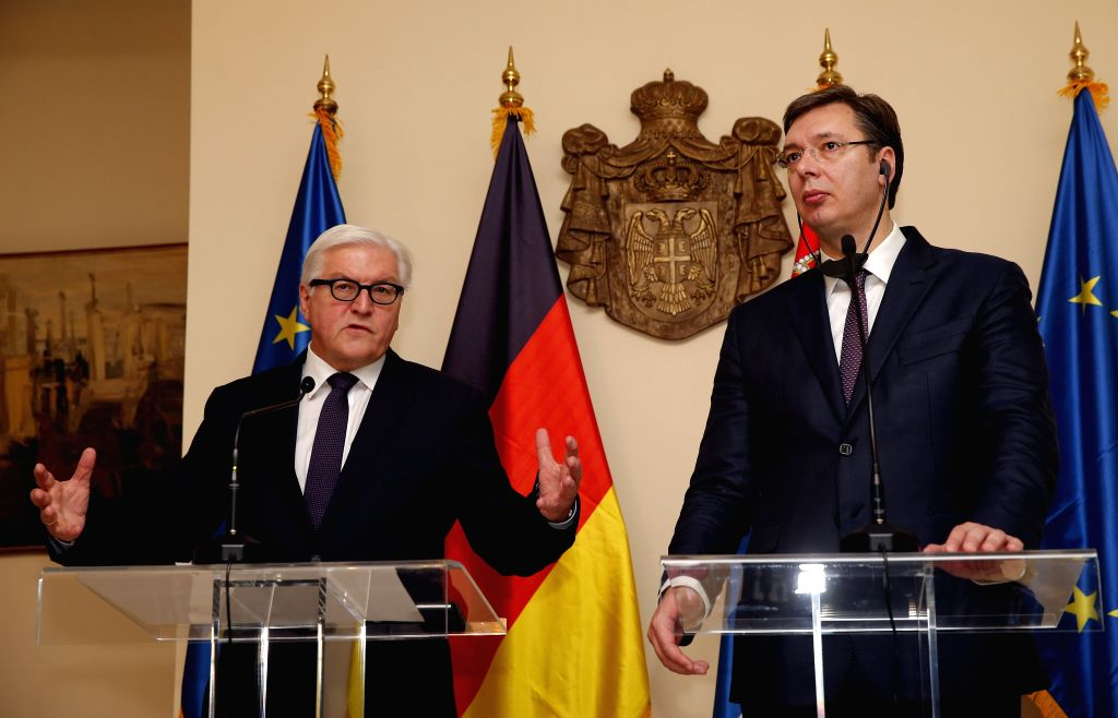 German Foreign Minister Frank-Walter Steinmeier (L) speaks at a press conference with Serbian Prime Minister Aleksandar Vucic (R) after their meeting at the 22nd ... - Frank-Walter Steinmeier