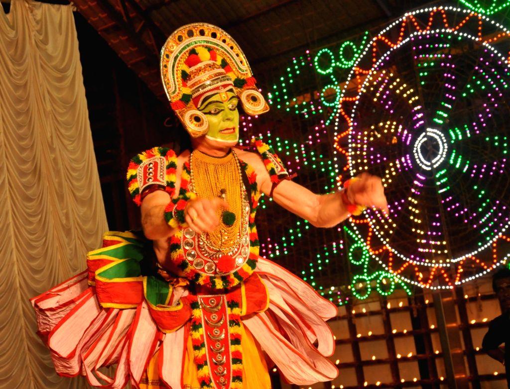 German national Hartmut Schmidt performs Ottanthullal - traditional dance of Kerala in Kochi on Jan 14, 2016.