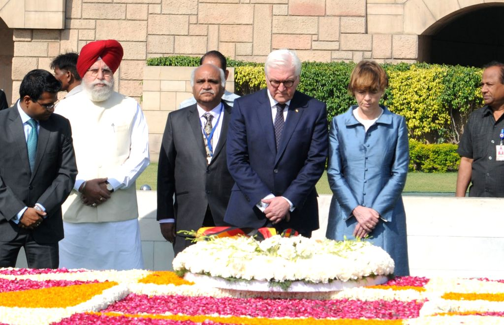 German President Frank-Walter Steinmeier along with his wife Elke Büdenbender pays floral tributes at the Samadhi of Mahatma Gandhi at Rajghat in New Delhi on March 24, 2018.