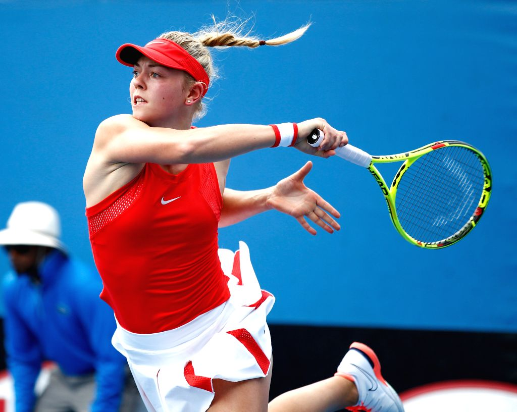 Germany's Carina Witthoeft competes against China's Zheng Saisai during the first round match of women's singles at the Australian Open Tennis Championships in ...