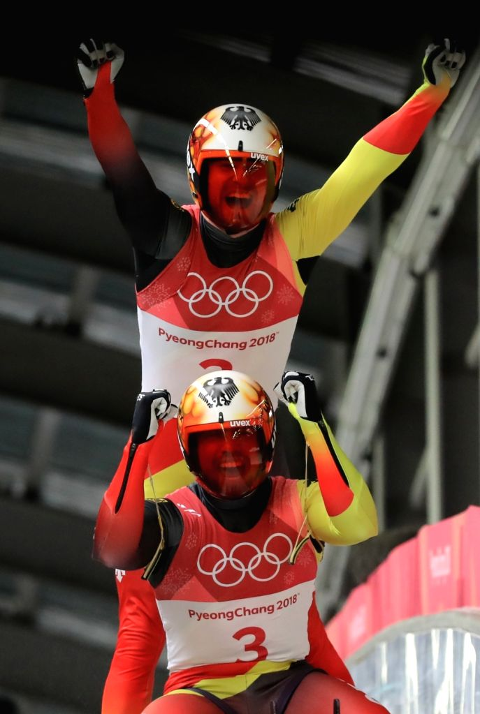 Germany's Tobias Wendl and Tobias Arlt react after clinching their second consecutive Olympic gold in men's doubles luge at the PyeongChang Winter Olympics in PyeongChang, east of Seoul, ...