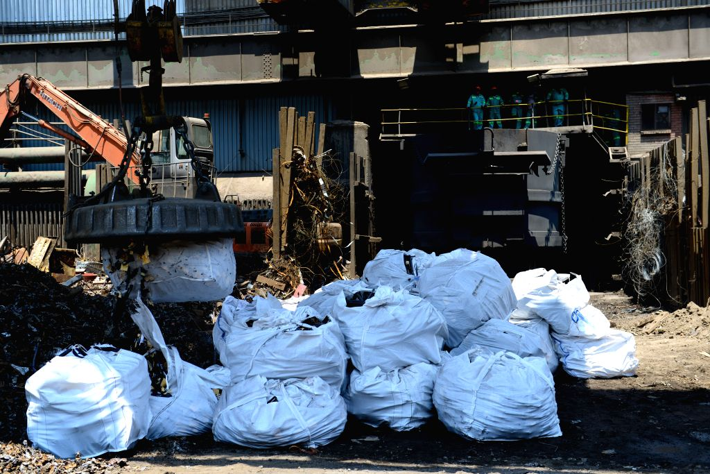 GERMISTON, Oct. 20, 2016 - A bag of illegal firearms is moved into the melting place at a factory of the Scaw Metals Group, Germiston, southeast of Johannesburg, South Africa, on Oct. 20, 2016. ...
