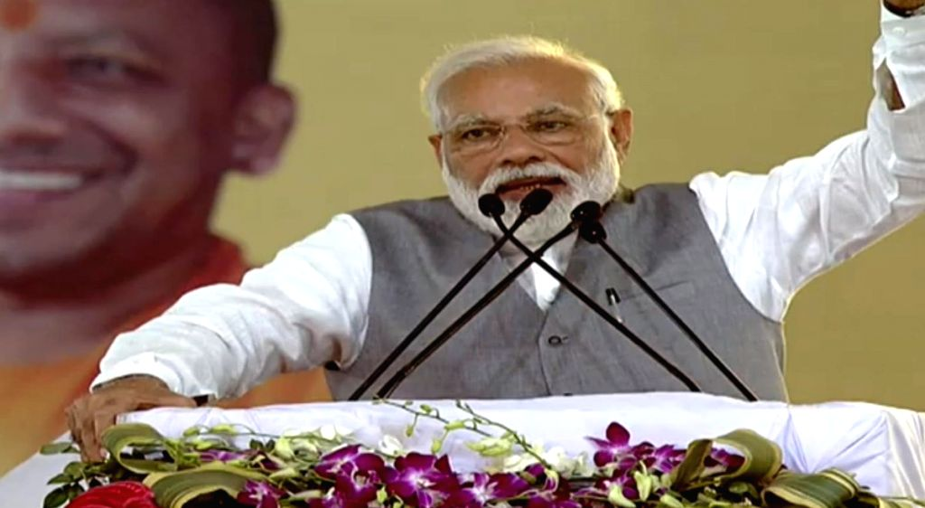 Ghaziabad: Prime Minister Narendra Modi addresses at the foundation stone laying ceremony of various development projects, in Kanpur, Uttar Pradesh, on March 8, 2019. (Photo: IANS/PIB) - Narendra Modi