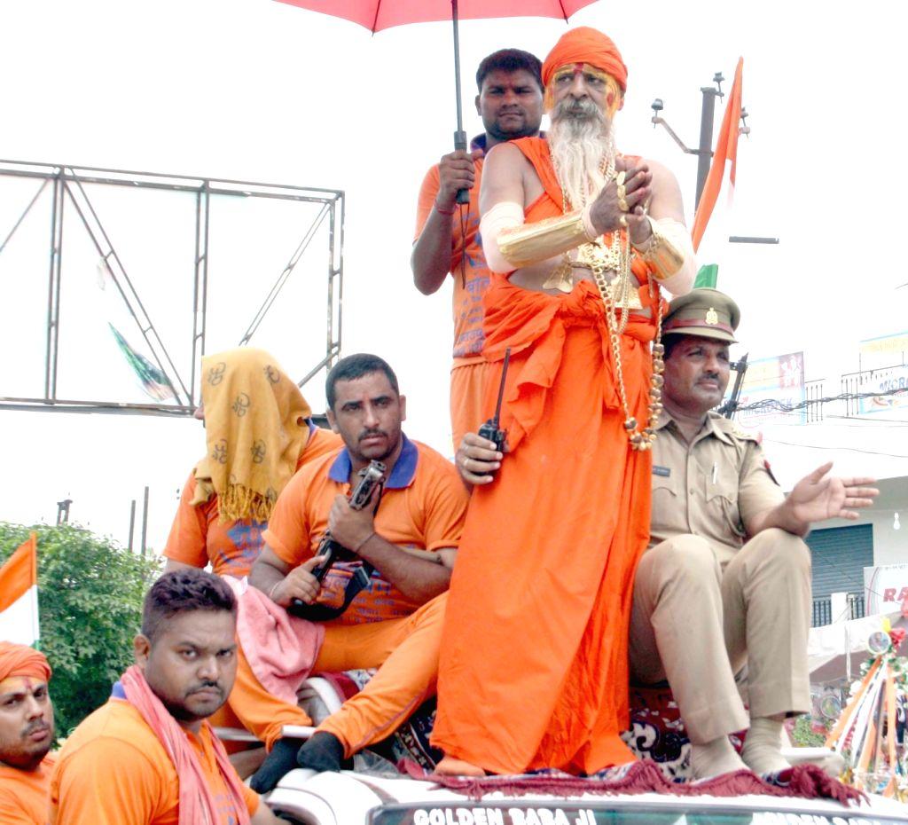 "Ghaziabad: Sudhir Kumar Makkar also known as ""Golden Baba"", bedecked with golden ornaments, passes through Ghaziabad on his way back to Delhi from Haridwar on July 19, 2017. (Photo: IANS) - Sudhir Kumar Makkar"
