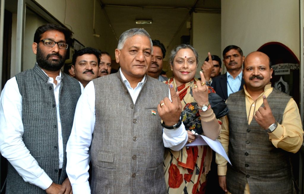 Ghaziabad: Union MoS External Affairs Gen. (Retd.) V.K. Singh shows his index finger marked with phosphorus ink as he comes out after casting vote during the second phase of Uttar Pradesh civic body polls in Ghaziabad on Nov 26, 2017. (Photo: IANS) - K. Singh