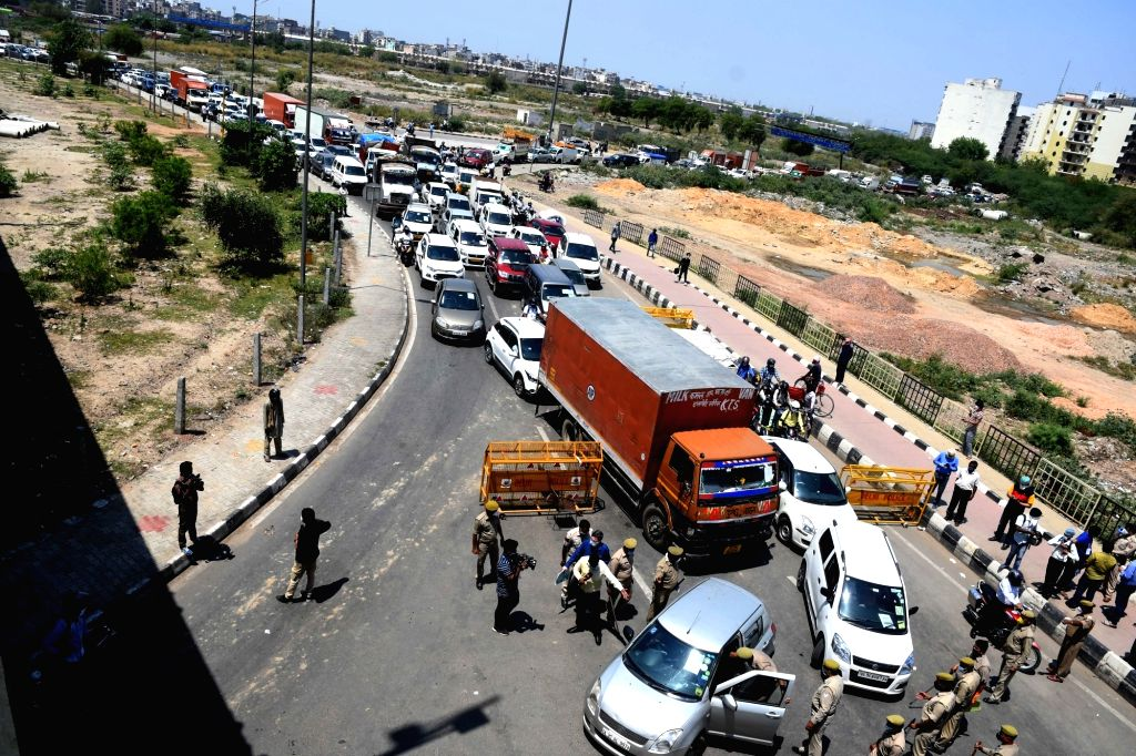 Ghazipur witnesses massive traffic jam as the Delhi-UP Border remains sealed during the extended nationwide lockdown imposed to mitigate the spread of coronavirus; on Apr 21, 2020.