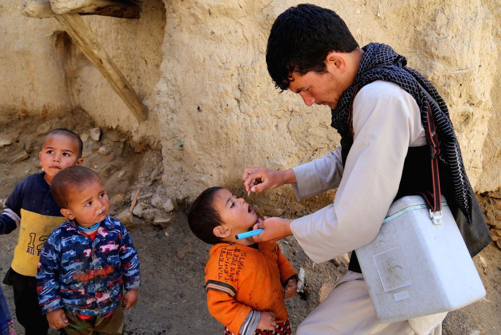 GHAZNI, April 18, 2016 - An Afghan child receives a polio vaccine during the anti-polio campaign in Ghazni province, eastern Afghanistan, April 18, 2016. An anti-polio campaign started in Ghazni on ...