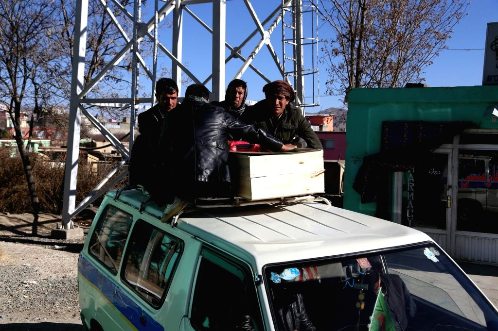 GHAZNI, Jan. 26, 2018 - Relatives of a victim place a coffin on the roof of a vehicle in Qara Baghi area of the eastern Ghazni province, Afghanistan, Jan. 26, 2018. A total of six civilians, all ...