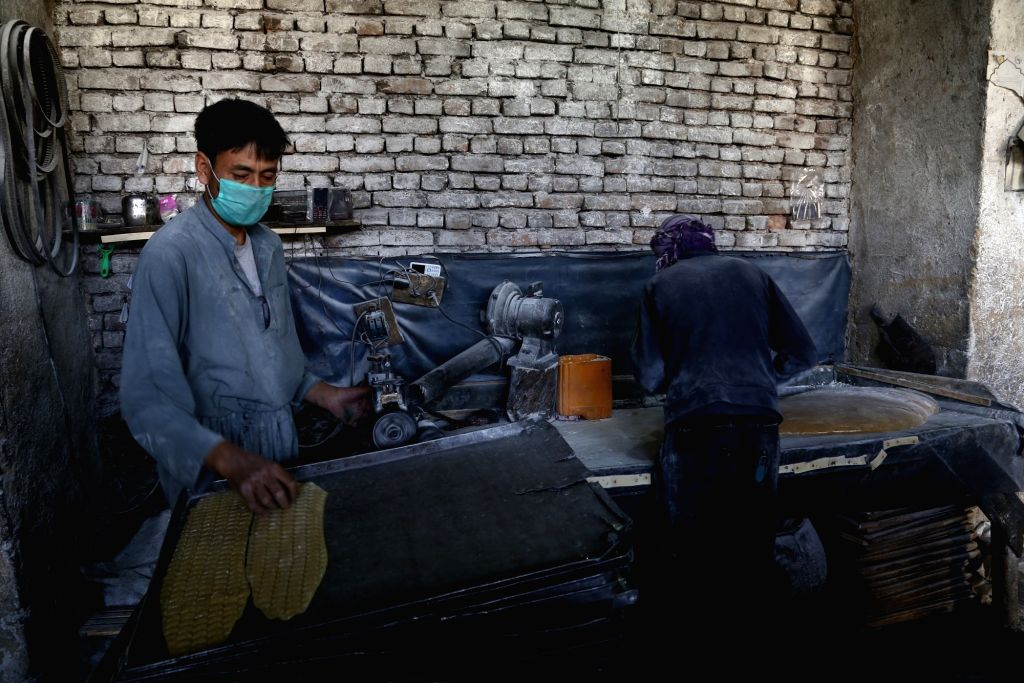 GHAZNI, July 25, 2017 - Two men work at a sweet factory in Ghazni province, Afghanistan, July 25, 2017.