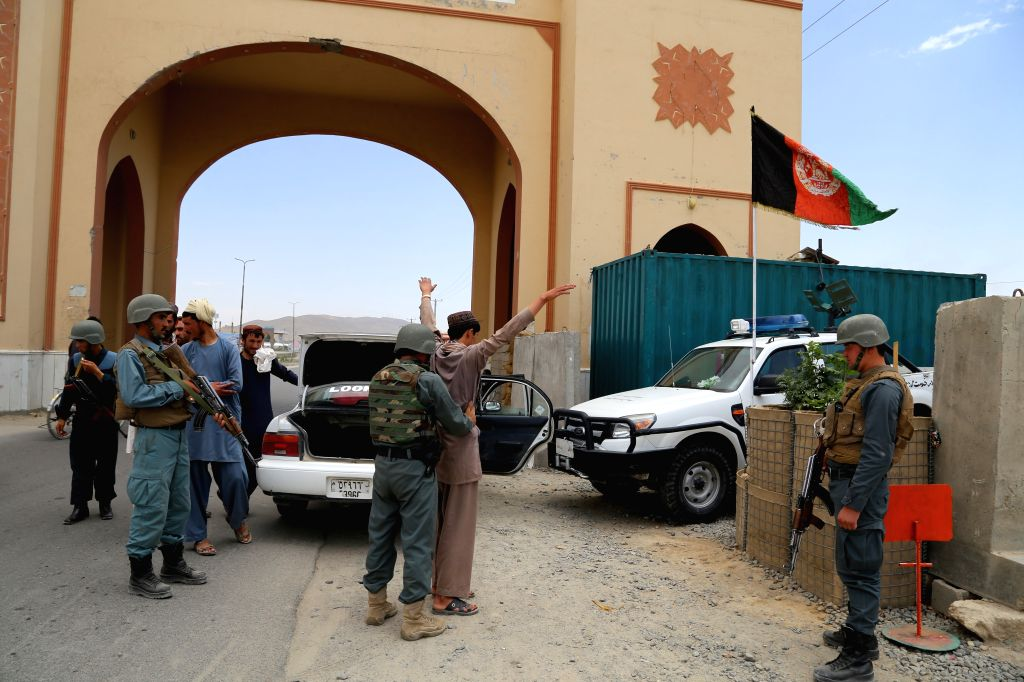 GHAZNI, July 5, 2016 - A policeman searches a passenger at a police checkpoint in Ghazni province, eastern Afghanistan, July 4, 2016. Afghan security forces have beefed up security measures across ...