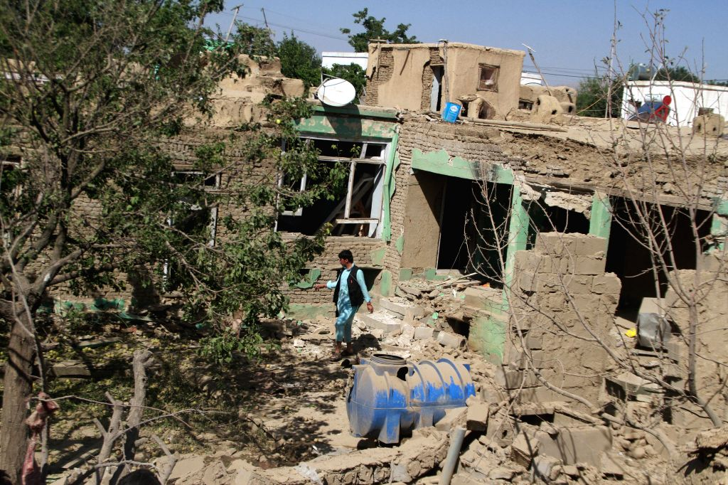 GHAZNI, July 7, 2019 (Xinhua) -- Photo taken on July 7, 2019 shows the damaged houses at the site of a car bomb attack in Ghazni, Afghanistan. At least six persons were killed and 96 others sustained injuries as a car bomb rocked Ghazni city, the cap