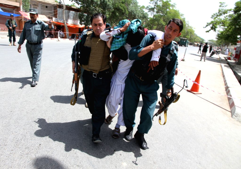 GHAZNI, June 1, 2016 - Afghan policemen carry an injured man from the site of a suicide attack in Ghazni province, Afghanistan, June 1, 2016. The number of those killed in the massive suicide attack ...