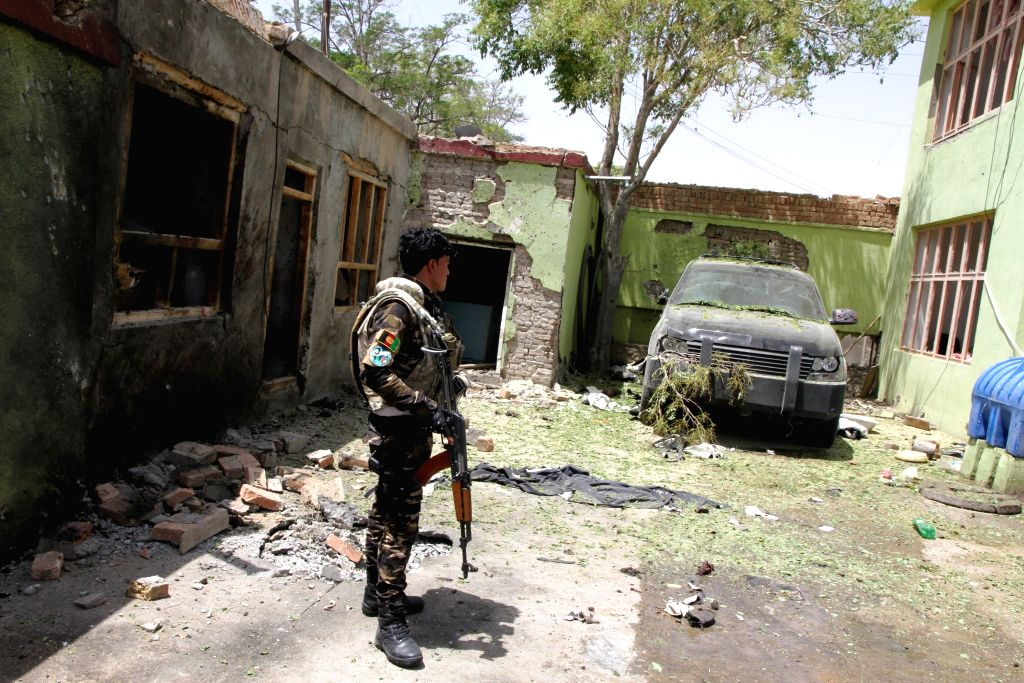 GHAZNI, June 1, 2016 - An Afghan security personnel member stands at the site of a suicide attack in Ghazni province, Afghanistan, June 1, 2016. The number of those killed in the massive suicide ...