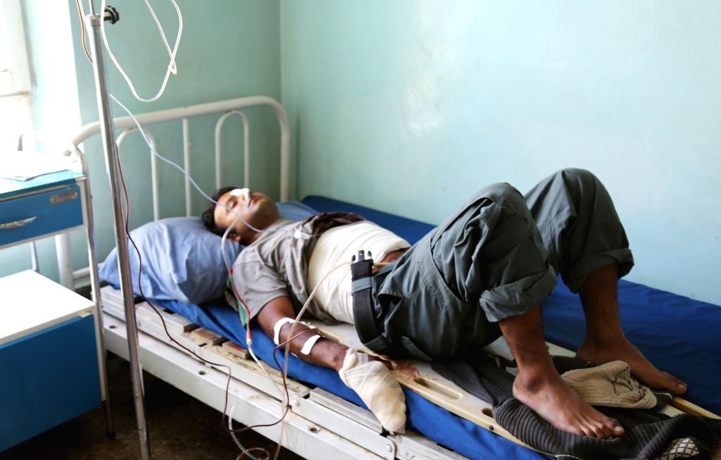 An Afghan wounded policeman receives medical treatment at a hospital in eastern Ghazni province of Afghanistan on May 12, 2014. Earlier on Monday, more than 300 ...