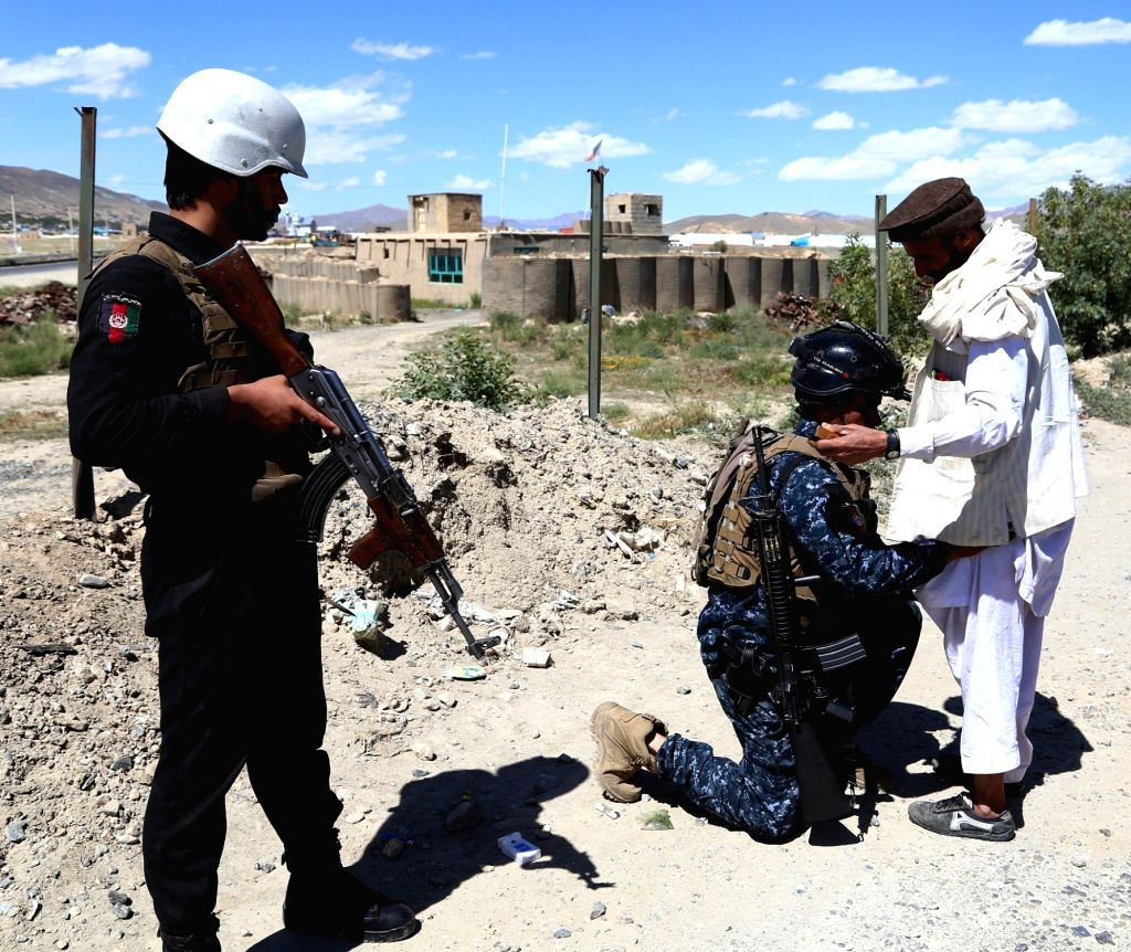 GHAZNI, May 23, 2018 - Afghan security members search a man at a checkpoint after Taliban attacks on Dih Yak and Jaghato districts in Ghazni city, capital of Ghazni province, Afghanistan, May 22, ...