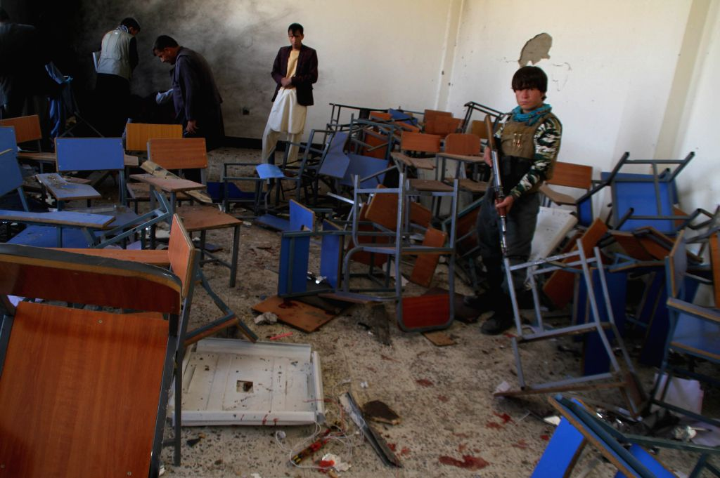 GHAZNI, Oct. 8, 2019 - Afghan security force members inspect the site of a blast in Ghazni province, Afghanistan, Oct. 8, 2019. A total of 19 students had been confirmed wounded in a blast that ...