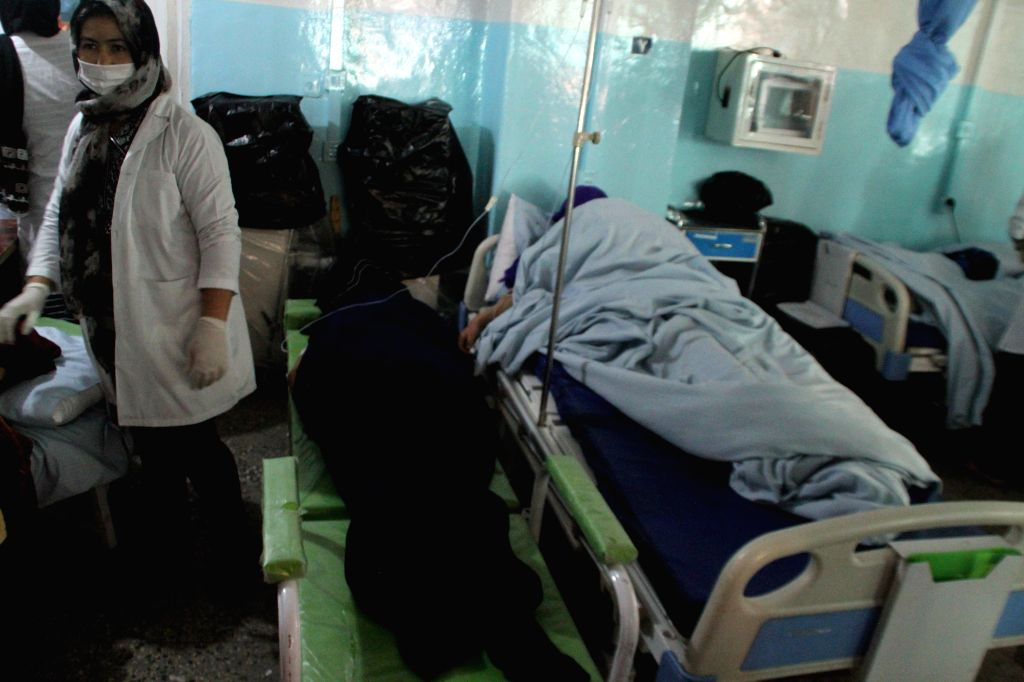 GHAZNI, Oct. 8, 2019 - Injured people receive medical treatment at a local hospital in Ghazni province, Afghanistan, Oct. 8, 2019. A total of 19 students had been confirmed wounded in a blast that ...
