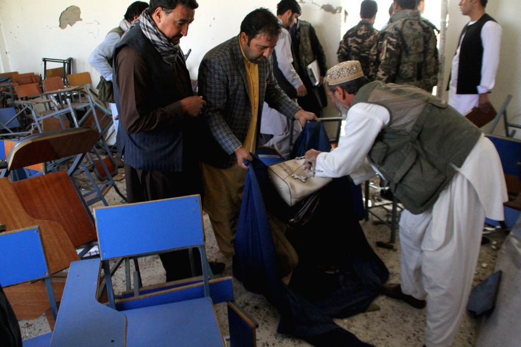 GHAZNI, Oct. 8, 2019 - People work at the site of a blast in Ghazni province, Afghanistan, Oct. 8, 2019. A total of 19 students had been confirmed wounded in a blast that rocked the Ghazni University ...