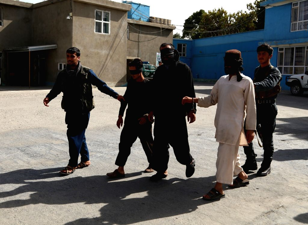 GHAZNI, Sept. 10, 2017 - Afghan police personnel escort three suspected Taliban militants in Ghazni province, Afghanistan, Sept. 10, 2017. Afghan police personnel captured three suspected Taliban ...